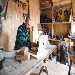 Portrait of bold moustache retired carpenter sitting at his workshop and working Stock Footage