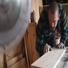 Focused bold carpenter with vintage moustache at work with wooden plank Stock Footage