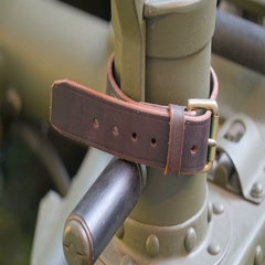 A brown belt hooked on a metal valve Stock Footage