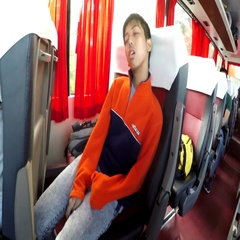 Boy seated sleeping on moving bus jolting Stock Footage