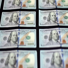 A Hundred Dollar Bill On Black Background Stock Footage