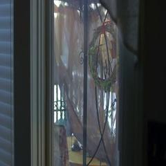 Weirdo with beard looking in window Stock Footage