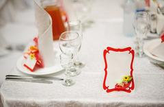 Reserved table for a wedding dinner and invitation card Stock Photos