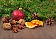 Different kinds of spices, nuts, dried oranges and cones, Christmas de Stock Photos