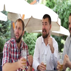 Three men sitting in cafe, drinking beer and making photo by mob Stock Footage