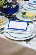 Beautiful setting wedding table with invitation postcard Stock Photos