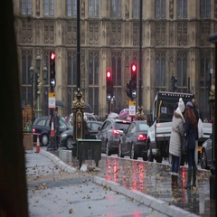 London traffic in the rain outside the Big Ben Stock Footage