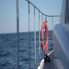 Board boat afloat with a lifeline Stock Footage