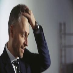 Fashionable man model businessman straightens hair Stock Footage