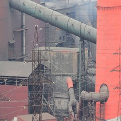 Old forties Copper-Nickel plant in smoke (smoulder roof). Stock Footage