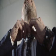 Fashionable man businessman corrects a tie Stock Footage