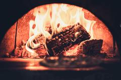 Fireplace in modern restaurant Stock Photos