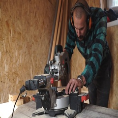 Bold carpenter with moustache Using Circular Saw for wood in his workshop. Stock Footage