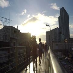 People walking on elevated metal walkway. silhouettes Stock Footage