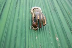 Antique hand door knocker Stock Photos