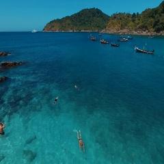PHUKET, THAILAND January 12, 2016: Long tail boats on the beach. Aerial. Stock Footage