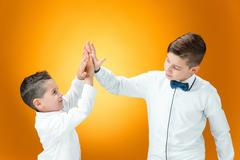 Happy children  congratulating by palms Stock Photos