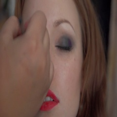 Stylist causes shadows on the upper eyelid for the model with brush for make-up Stock Footage