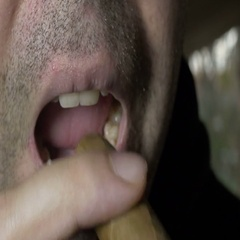 Putting cigar in mouth Stock Footage