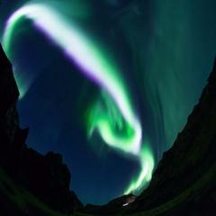 Extremely bright aurora borealis steep mountain canyon Iceland realistic 4k Stock Footage