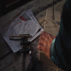 Carpenter's hands using drill on wooden plank Stock Footage