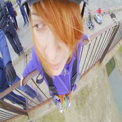 Girl jumping from the bridge forward looking at the instructor Stock Footage