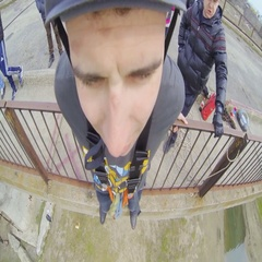 A man jumping off a bridge with a frightened face Stock Footage