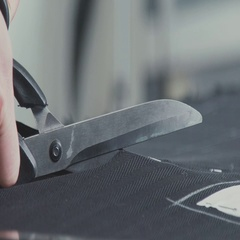 Equipment for the seamstress. Close-up: the scissors cuts the fabric Stock Footage