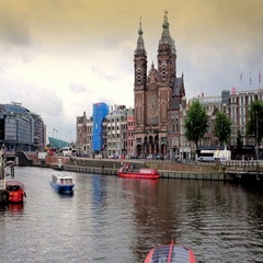 View of st Nicholas church along the river in Amsterdam , Netherlands Stock Footage