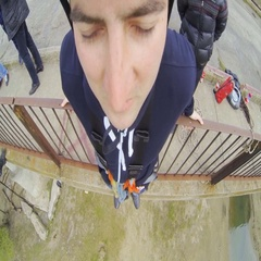 A man jumping off a bridge with a frightened face forward Stock Footage