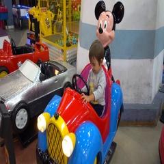 Child on fairground attraction ride Stock Footage