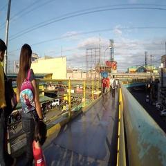 People walking on complex elevated metal walkway Stock Footage