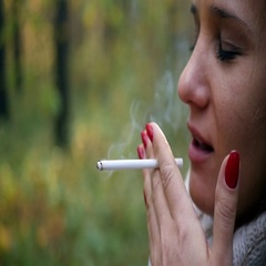 She coughs up cigarettes Stock Footage