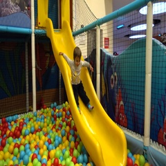 Child slides at the play area Stock Footage