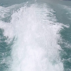 Blue ocean sea water wave with fast yacht boat wake foam of prop wash Stock Footage