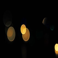 Flicking abstract colorful bokeh, dark background Stock Footage