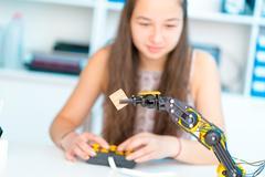 Teen girl in robotics laboratory Kuvituskuvat