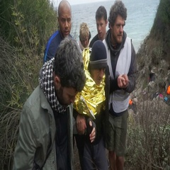 LESVOS, GREECE - NOV 5, 2015: Volunteers help old refugee to go on shore Stock Footage