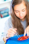 Install an Integrated Circuit into a Circuit Board Stock Photos
