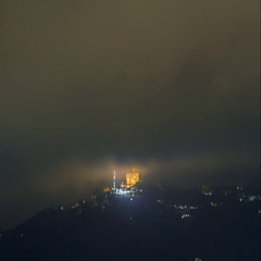 Night timelapse with foggy clouds above Sagrat Cor, Barcelona, Spain. Stock Footage