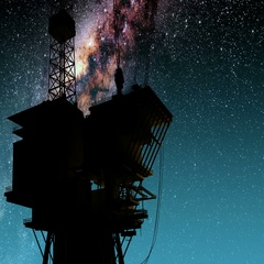 Silhouette of oil rig and Milky Way stars at night. Stock Footage