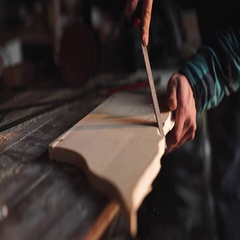 Close-up of a Carpenter working on a Wooden Window Frame with a File in his Stock Footage