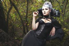 Woman witch in corset. Stock Photos