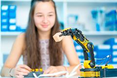 Teen girl in robotics laboratory Stock Photos