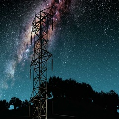 Electricity pylons and lines. Milky Way stars at night.  Stock Footage