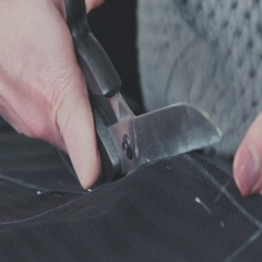 Cutting fabric. Сut out of a fabric for clothing in a design studio Stock Footage