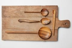 Kitchenware set of wooden plate,  spoons,  knife Stock Photos