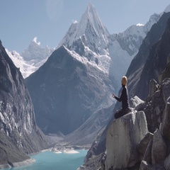 Woman meditating on the peak of Andean mountains Stock Footage