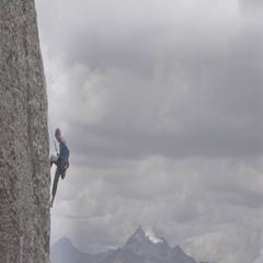 Climber on vertical wall of the Andean mountains Stock Footage