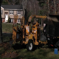 Wood chipper in a residential area Stock Footage